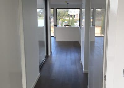 Hallway with Dark Floorboards